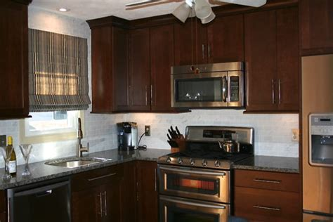 New Caledonia Dark Cabinets Backsplash Ideas