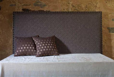 cabecero liso tapizado  tachuelas en portobellostreetes