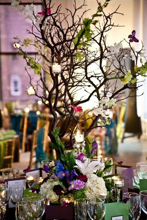 colorful manzanita branches  centerpieces elegant