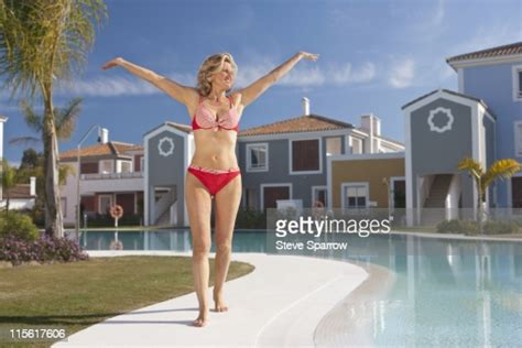 woman  arms stretched   pool high res stock photo