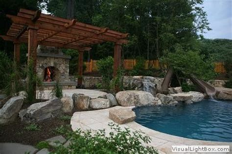 pergola raised patio fireplace pool with waterslide