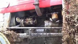 Changing The Oil Filter On A Massey Ferguson 135 Tractor
