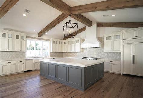 ivory cabinets  grey island transitional kitchen