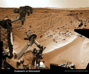 Mars rover Scooping in Search of Pristine material at ...