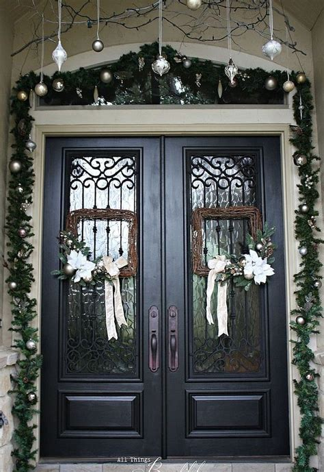how to hang garland around front door christmas porch and front door garland diy hometalk