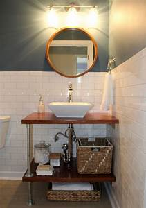 Diy bathroom vanity ideas perfect for repurposers for Making a bathroom cabinet