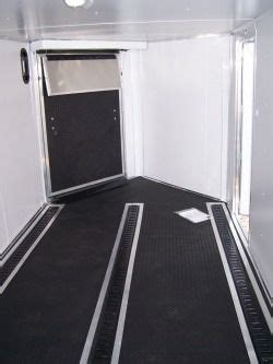 Rubber trailer flooring provides good traction and footing for animals. Front Ramp Trailer with Alpha Rubber Floor and three lines ...
