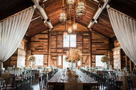 elegant barn wedding featuring bold red blooms
