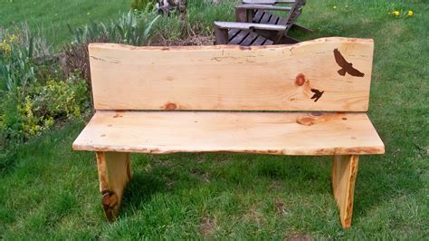 Salvaged live edge wood slab bench with inlays. SALE PENDING