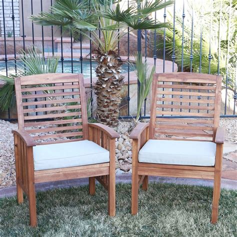 acacia wood outdoor chairs light brown w beige cushions