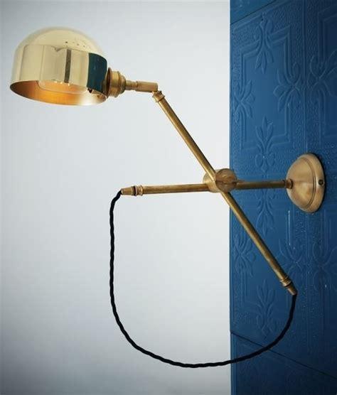 polished brass adjustable arm swing wall light