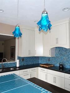 Kitchen island lighting in large deep turquoise art glass