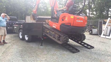 loading  excavator   pj   pro dump trailer youtube