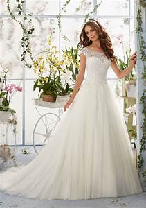 embroidered lace overlays the bateau bodice on soft net With wedding dress overlay