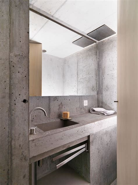 Modern Bathroom Finishes by Concrete Minimalist Cabin In The Swiss Alps Concrete