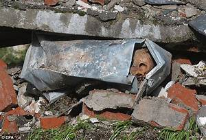 70 coffins swept away by rain after floods hit cemetery in ...