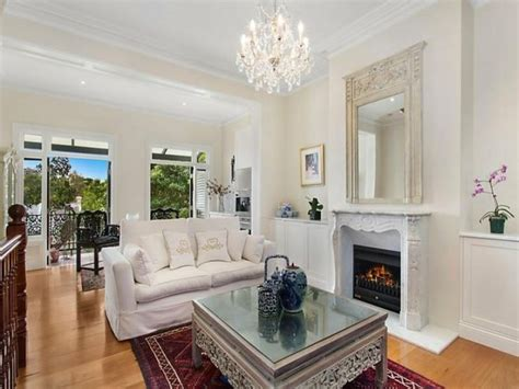 narrow mirror living room with white fireplace ornate