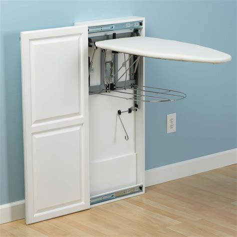 portable ironing board cabinet the fold out ironing board cabinet hammacher schlemmer