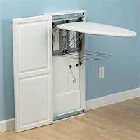 ironing board cabinet The Fold-Out Ironing Board Cabinet - Hammacher Schlemmer