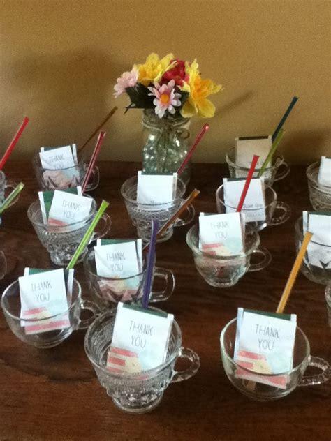 diy bridal shower favors green tea bag honey stick and thank you tag inside a glass tea