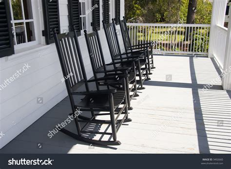 four rocking chairs on front porch stock photo 3492660