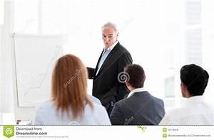 Senior Manager Giving A Presentation Stock Photo
