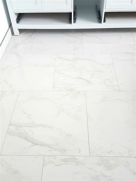 choosing faux carrara marble floor tile for the bathroom