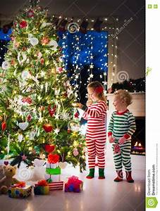 Kids Decorating Christmas Tree Stock Image - Image: 77604415