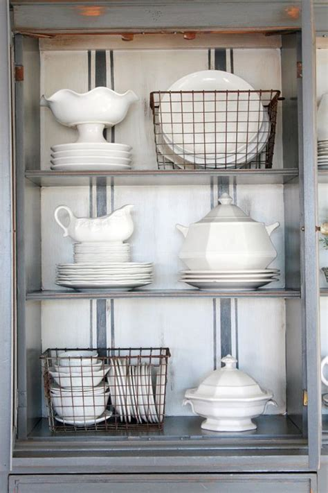 how to organize a china cabinet organize this china cabinet