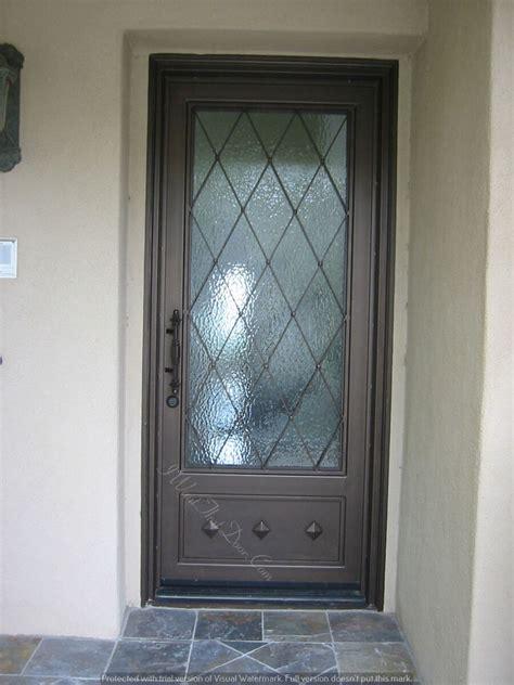 diamond shaped single entry iron door design  square top