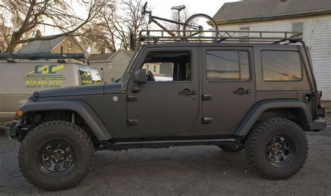 matte tan jeep matte blacked out 4 door jeep wrangler w 3rd row drool