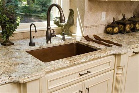 azul platino granite with colored cabinets also