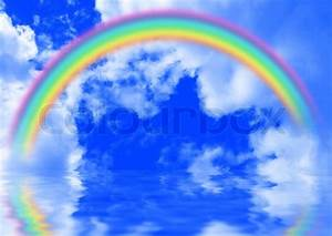 White fluffy clouds with rainbow in the blue sky | Stock ...