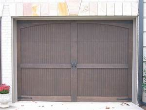 Best real carriage doors prices all about house design for Carriage style garage doors prices