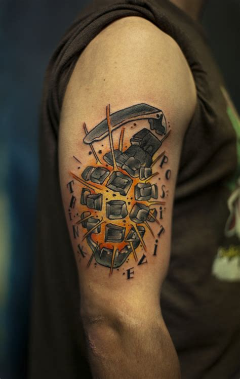 exploding grenade arm tattoojpg