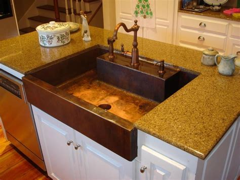 Photos of copper sinks in kitchens