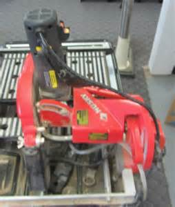 lot 674 husky tile saw w blade stand model thd950l