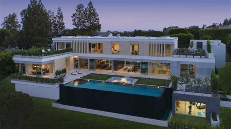 glass lined  construction  bel air hits market   million mansion global