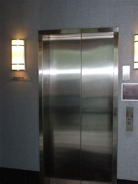 brush stainless header  jamb cladding  elevator
