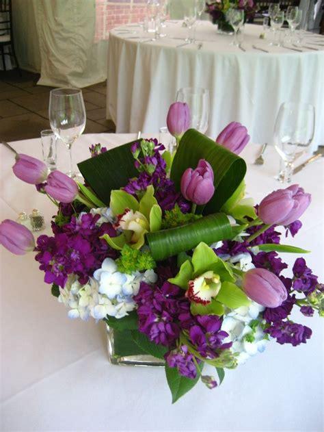 Fun Purple Centerpiece With Stock Tulips Green Cymbidium