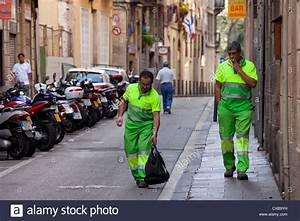 Two sanitation workers in Barcelona are easily spotted in ...
