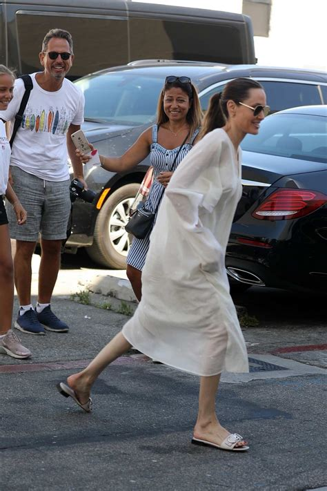 angelina jolie and her kids shop for purses at the ysl ...