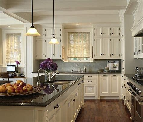 white or cream kitchen cabinets dark floors countertop light cabinets kitchens