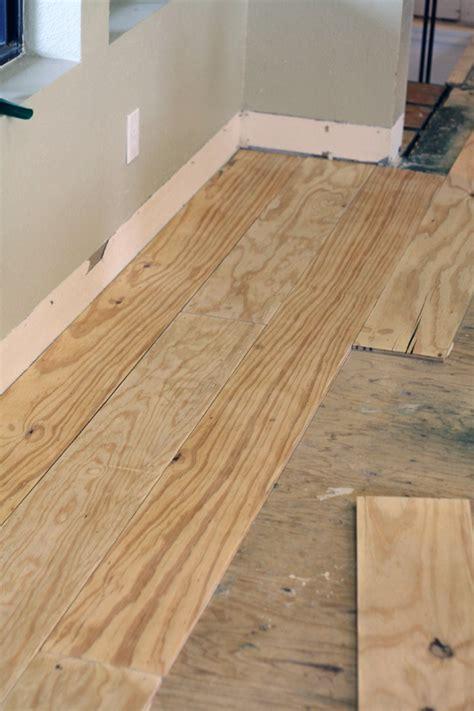 diy plank flooring little green notebook diy wide plank floors made from plywood crafty diy pinterest