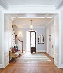 This crisp foyer is painted in Gray Screen by Sherwin ...