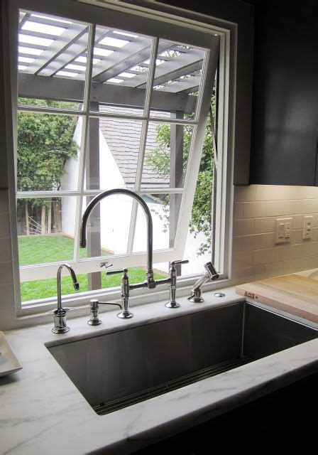 wainscoting kitchen cabinets 17 best ideas about window sink on 3303