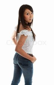 Beautiful youngwoman wearing jeans and looking back over her shoulderPretty mixed race asian ...