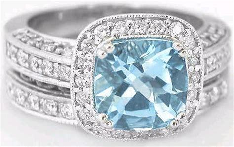 cushion cut aquamarine  diamond halo engagement ring