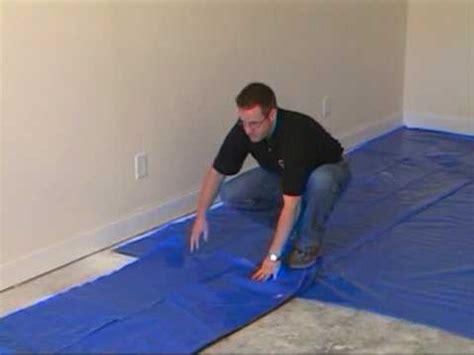 vapor barrier for laminate concrete how to install the moisture barrier over concrete subfloor youtube