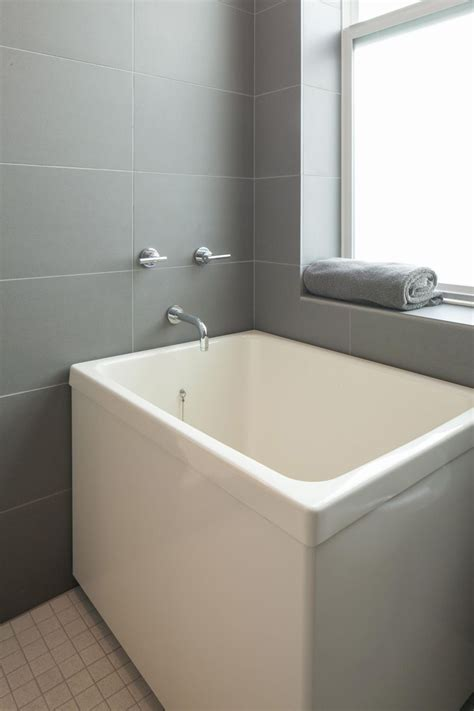 Soaking Tub With Shower by Japanese Soaking Tub Takes Up Less Floor Space Could Add